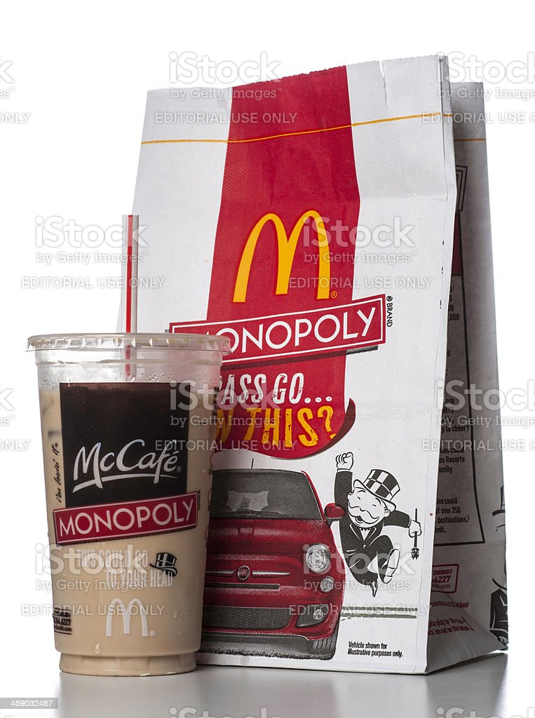 McDonalds McCafé monopoly promo on paper bag and coffee cup stock photo