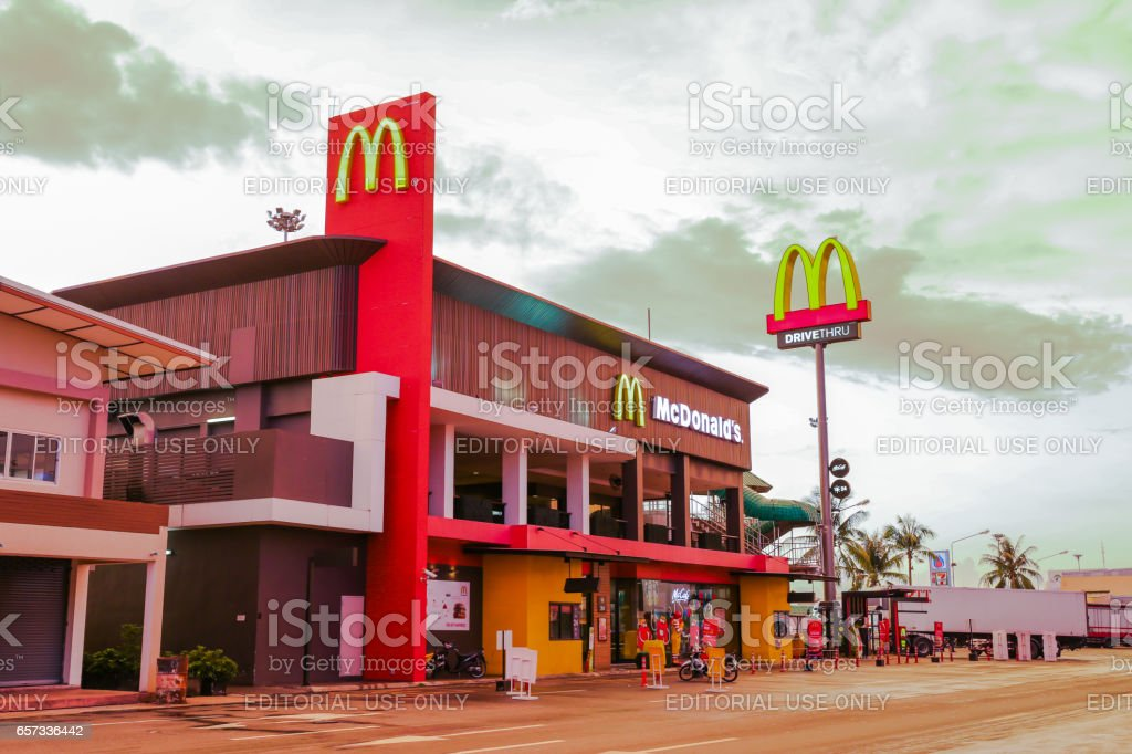 CHACHOENGSAO, THAILAND- MARCH 22, 2017  : A McDonald's restaurant at the Motorway Rest Area, Chachoengsao province in twilight time. It is the largest restaurant on this road in Thailand . stock photo