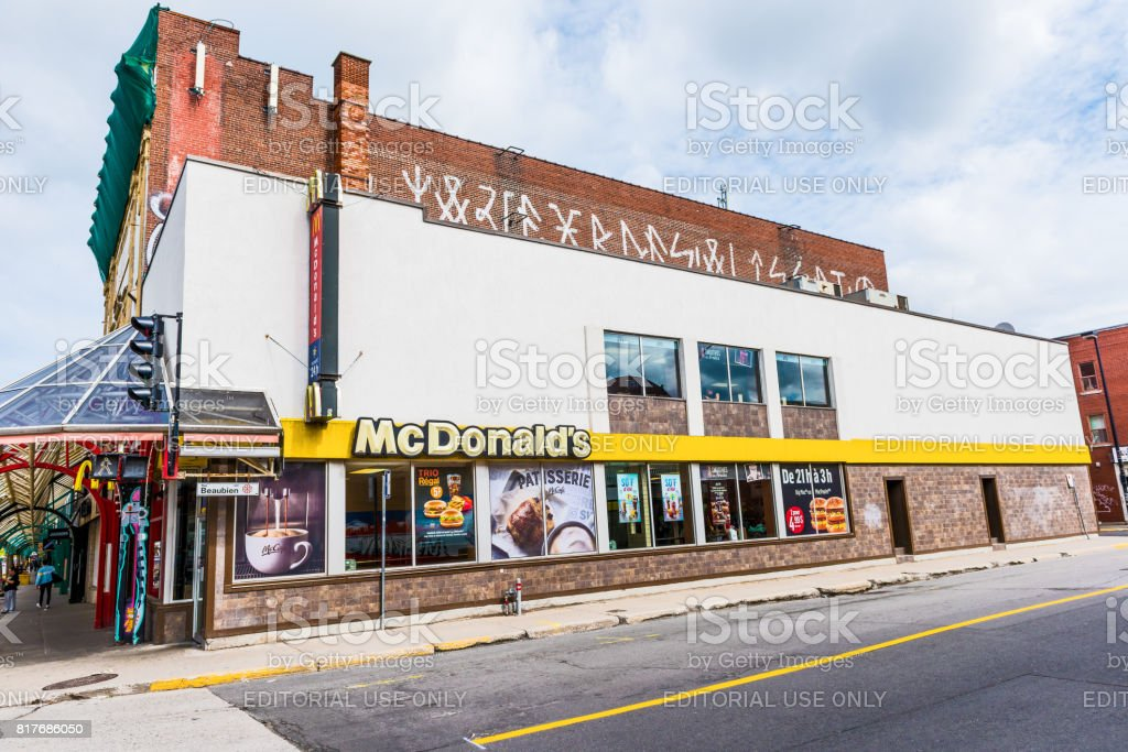 McDonalds sign and logo by St Hubert street on Rue Beaubien in Plateau neighborhood in city in Quebec region stock photo