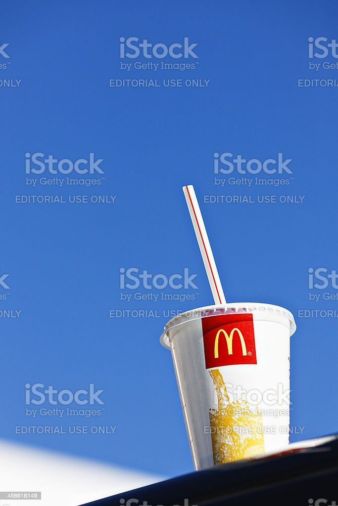 McDonald's soft drink container on roof of car outside branch stock photo