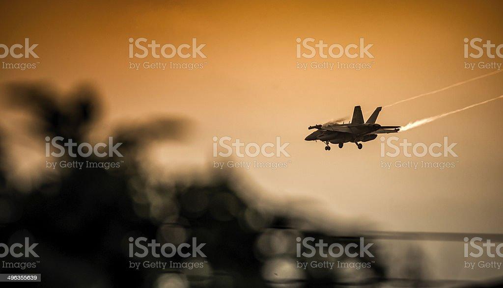 McDonnell Douglas F/A-18 Hornet Landing approach sunset stock photo