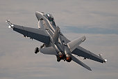 F-18 Hornet, modern combat airplane taking off.