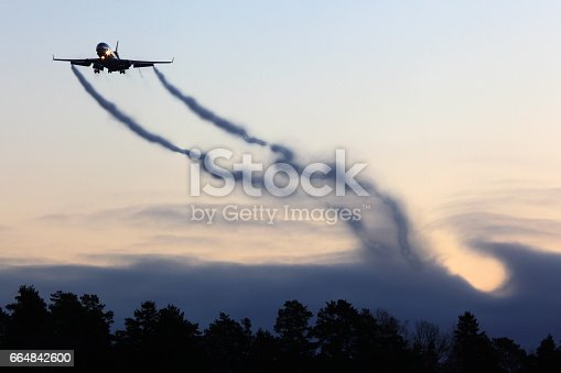 istock Mcdonnell Douglas MD-11F civil cargo airplane landing with vortexes coming from wingtips 664842600
