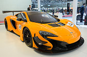 Geneva, Switzerlands - March 2, 2016: Front view of a yellow McLaren 650S GT3 racer sports car shown at the 86th International Geneva  Motor Show in Palexpo, Geneva.