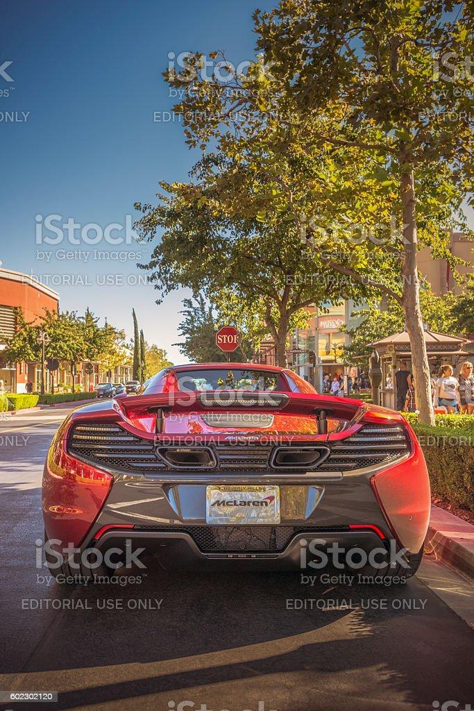 McLaren 650S Stares Down Stop Sign stock photo