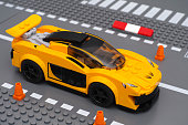 Tambov, Russian Federation - March 05, 2015: McLaren P1 car by LEGO Speed Champions on the Lego road baseplate with driver inside car. Studio shot. LEGO Speed Champions is a collection of authentic, realistic and buildable cars from iconic brands such as McLaren, Porsche and Ferrari.