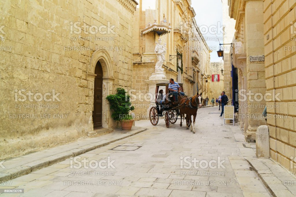 Mdina, Malta. Antique cityskype view with tourist horse carriage. stock photo
