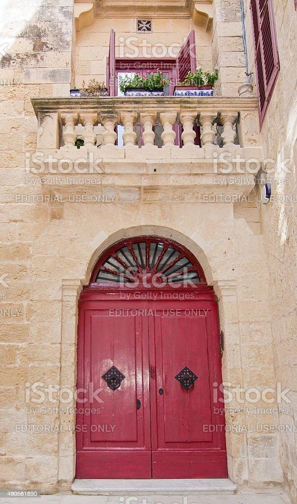 Mdina red door stock photo