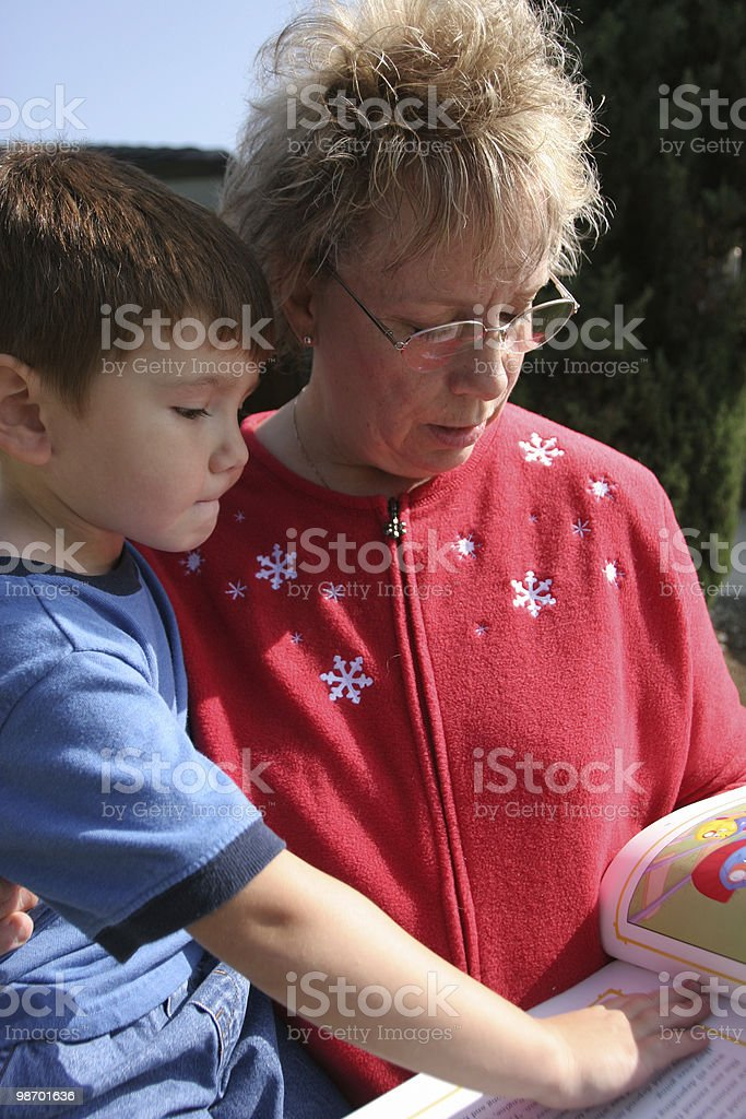 Me and grammy reading royalty-free stock photo