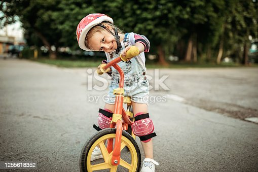 Girl learning to drive a bicycle
