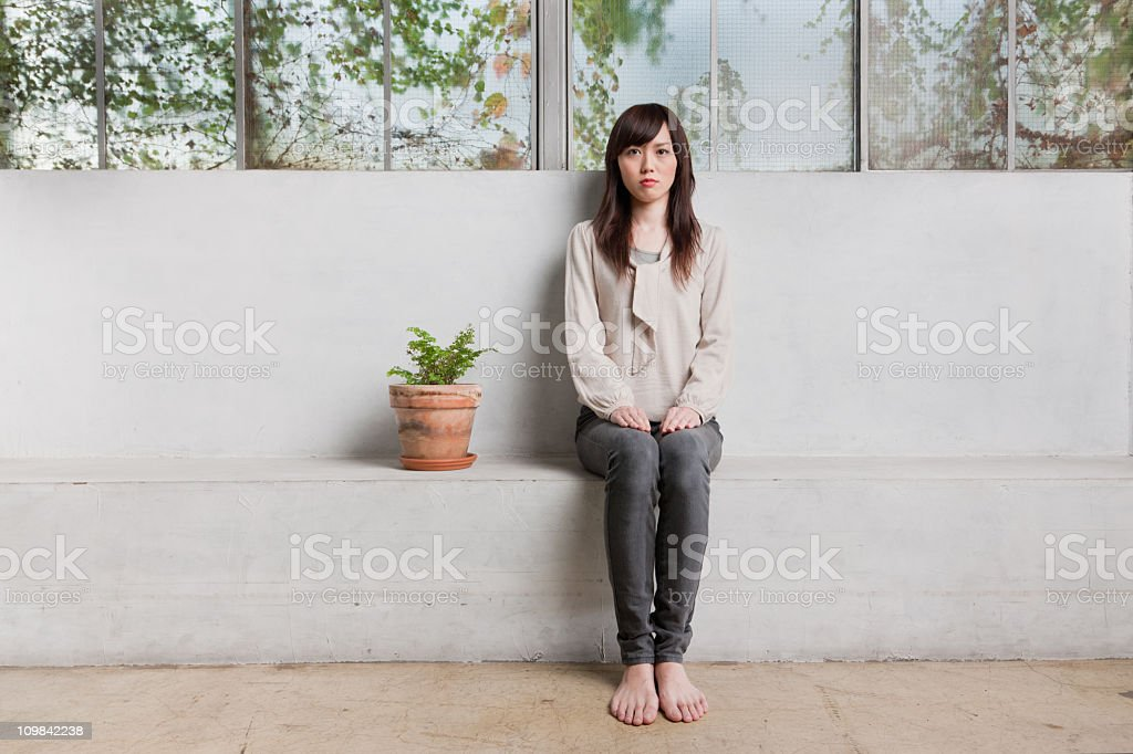Me and my Houseplant - Japanese Woman Portrait royalty-free stock photo