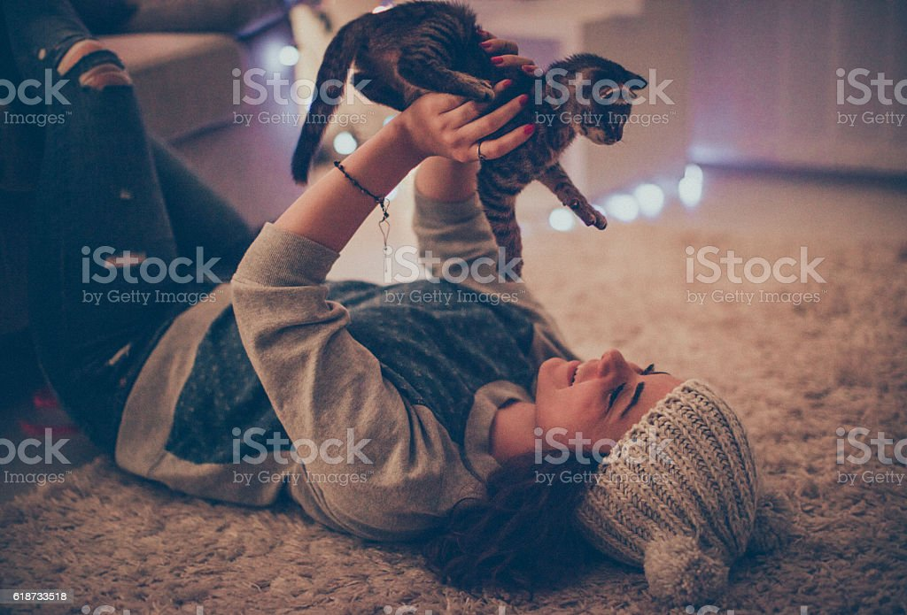 Me and my playful cat on New Year's Eve stock photo
