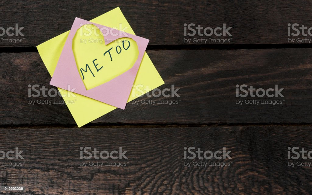 me too text in love heart sticker on wooden background stock photo