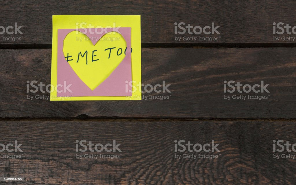 me too text in love heart sticker.Sexual harassment concept stock photo