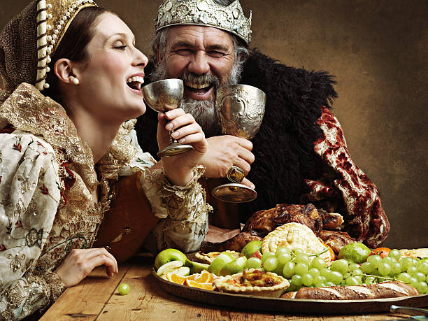 Mead and merriment A mature king feasting alone in a banquet hall royalty stock pictures, royalty-free photos & images