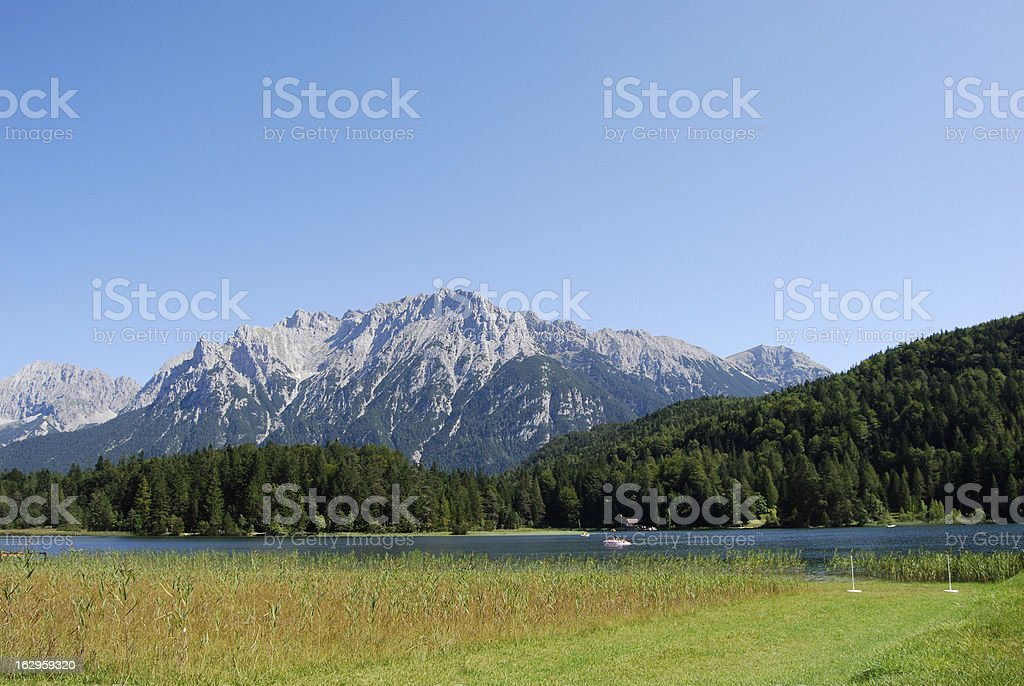 Meadow and idyllic lake in bavaria stock photo