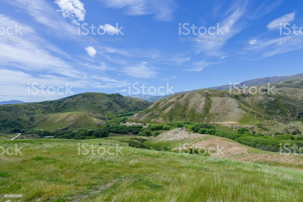 Meadow and valley in New Zealand stock photo