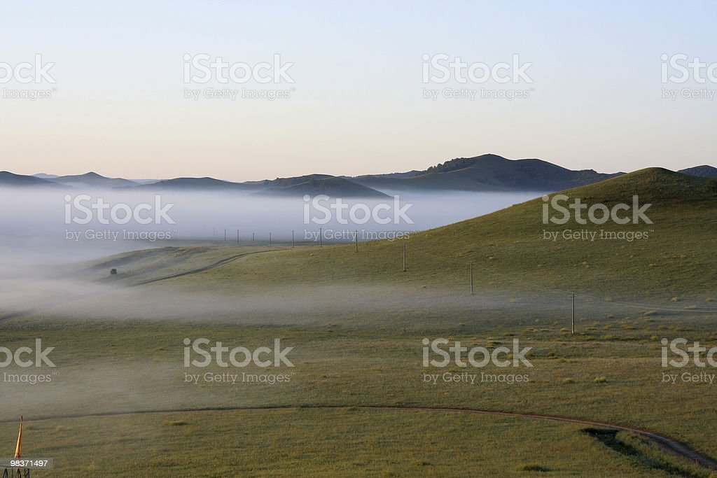 meadow in morning fog royalty-free stock photo