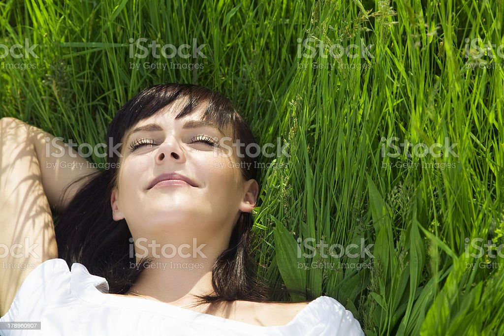 meadow beautiful girl lying down of grass. Copy space 20-24 Years Stock Photo