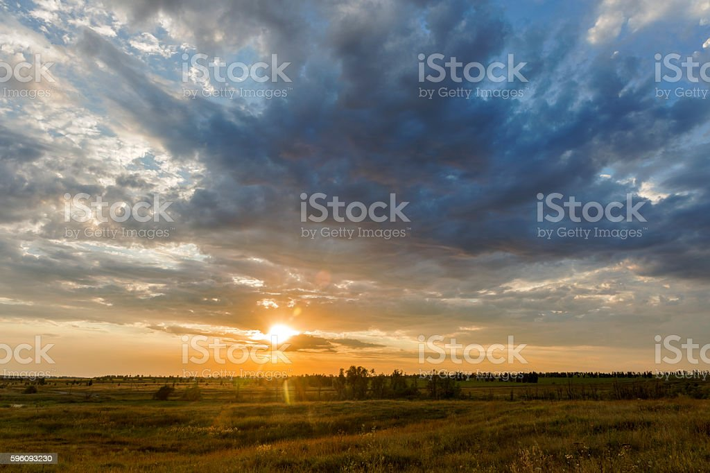 meadow sunset clouds. royalty-free stock photo