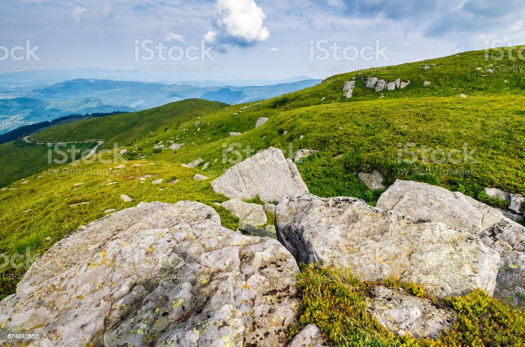 meadow with boulders in Carpathian mountains in summer royalty-free stock photo
