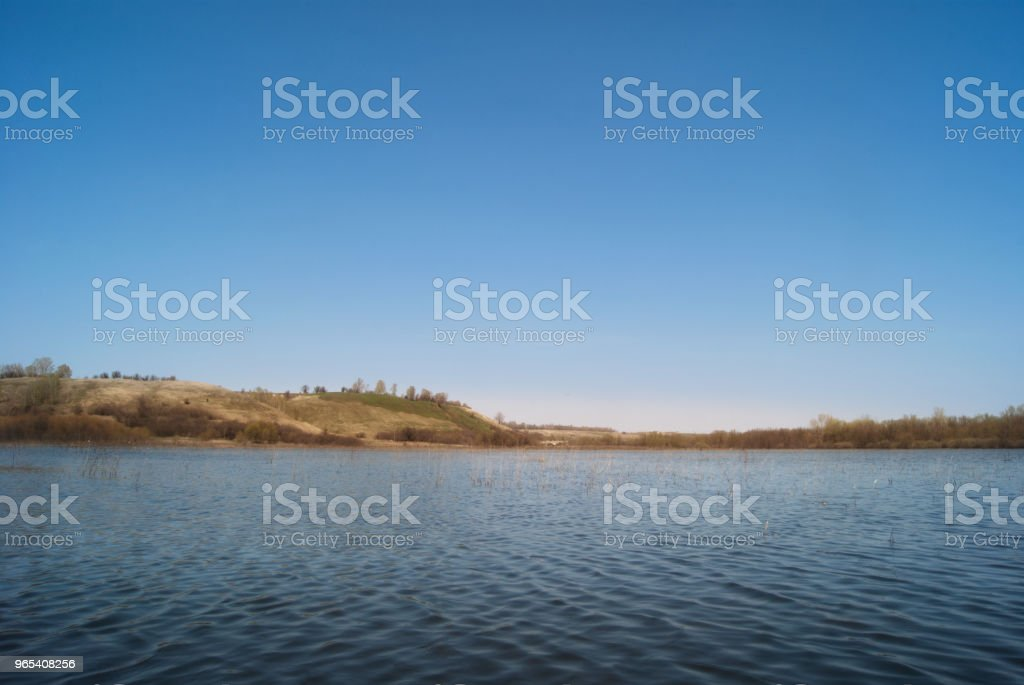 Meadows and pastures in hilly valley flooded with a spring river stream zbiór zdjęć royalty-free