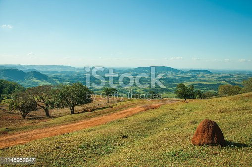 485413653istockphoto Meadows in a green valley with mound of tinder land 1145952647