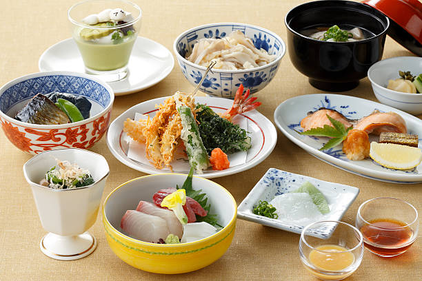 Meal of sushi with tuna, shrimp, tempura on the table ストックフォト