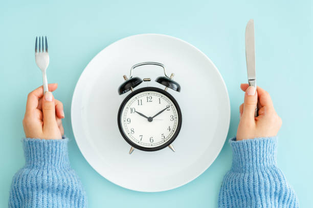 Meal planning for diet concept Blue, Breakfast, Clock, Concepts, Plate intermittent fasting stock pictures, royalty-free photos & images