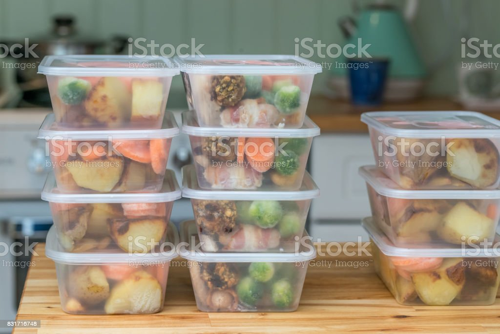 Meal prep. Stack of home cooked roast dinners stock photo