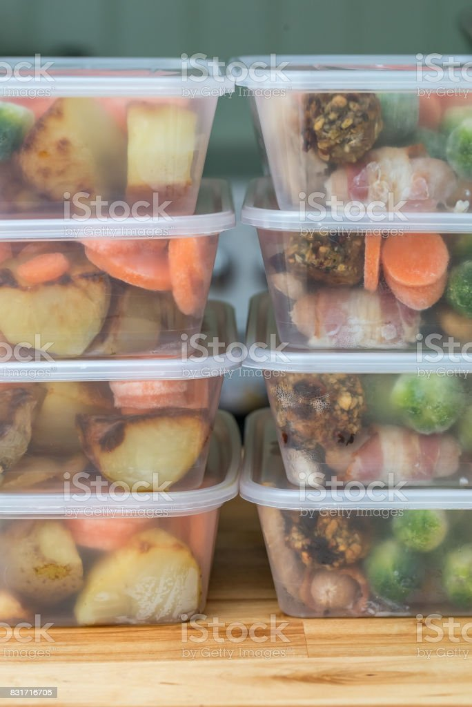 Meal prep. Stack of home made roast dinners. Vertical. Meal prep. Stack of home cooked roast chicken dinners in containers ready to be frozen for later use. Vertical. Antioxidant Stock Photo