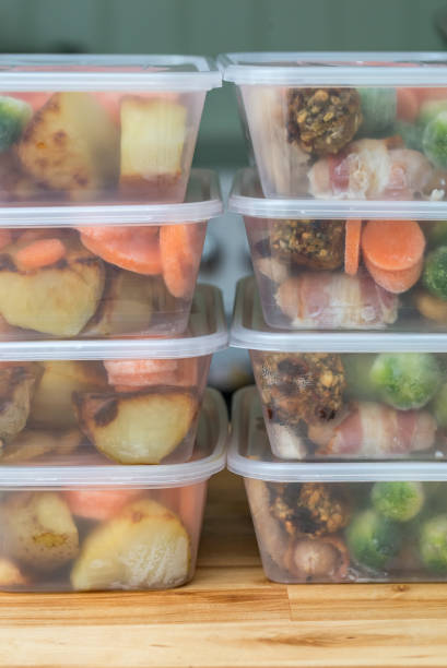 Meal prep. Stack of home made roast dinners. Vertical. stock photo