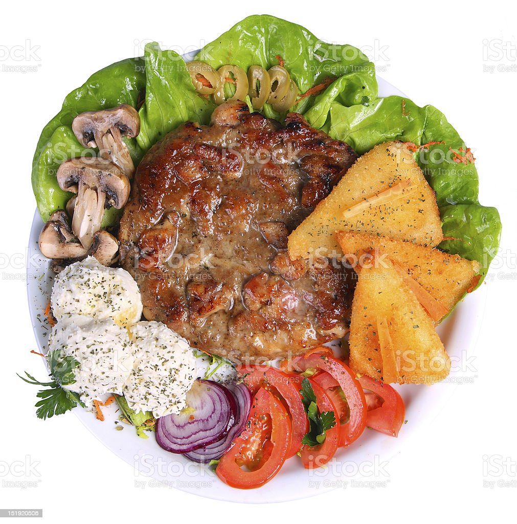 meal with burger, cheese, and vegetables, top angle royalty-free stock photo