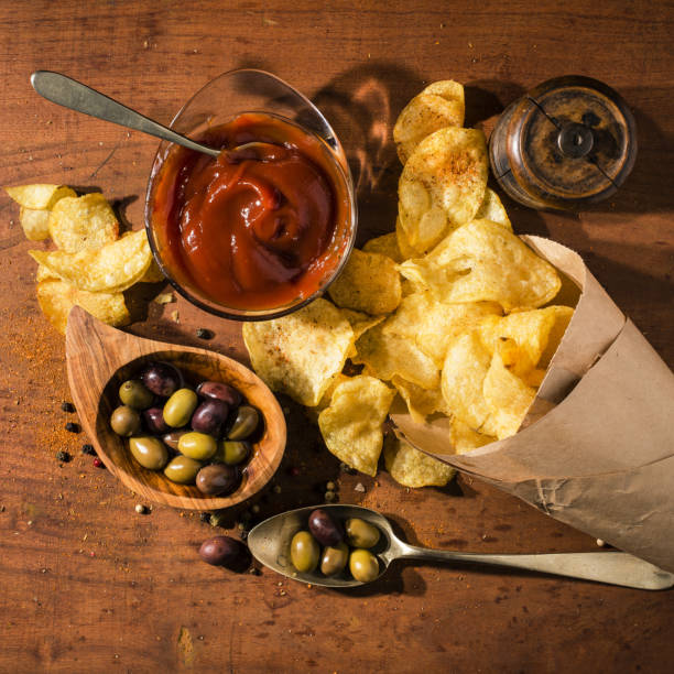 meal with ketchup and fries meal with fries and ketchup a bowl with olives and spices patatine fritte stock pictures, royalty-free photos & images