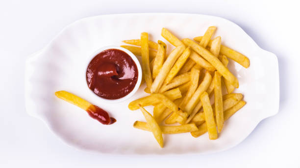 meal with ketchup and fries bowl with tomato sauce and fried potatoes isolated from the white background patatine fritte stock pictures, royalty-free photos & images
