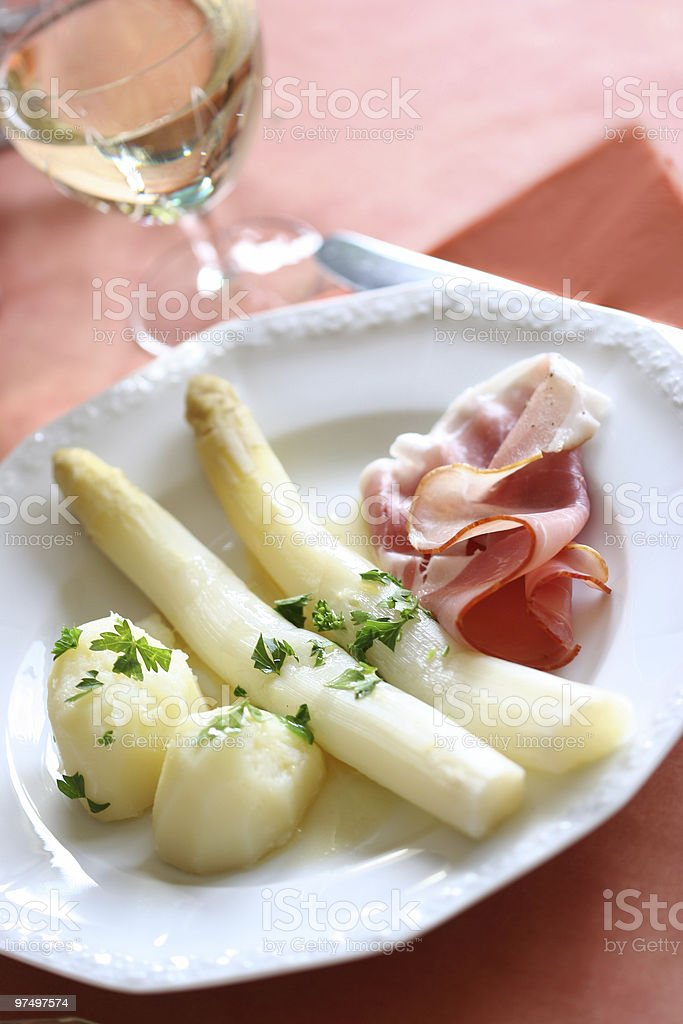 Meal with white asparagus and meat royalty-free stock photo