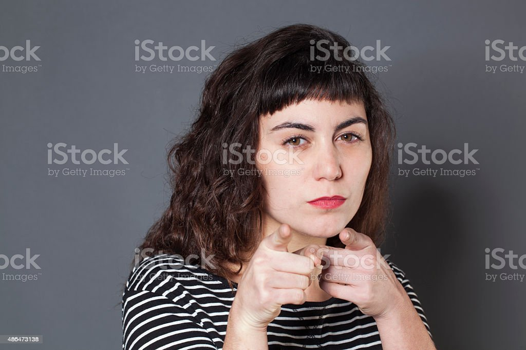 mean 20s woman threatening someone with discretion stock photo
