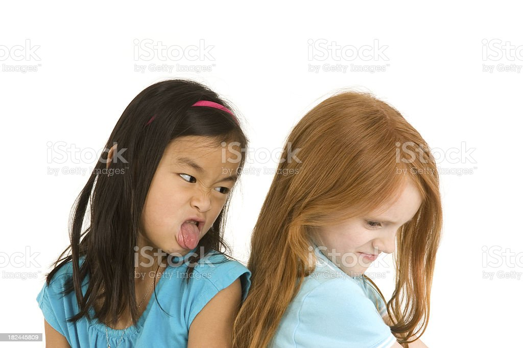Mean girl sticking out tongue stock photo