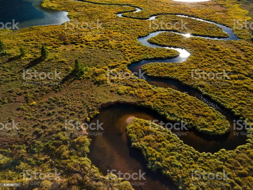 Meandering Creek Curves into Lake Inlet stock photo