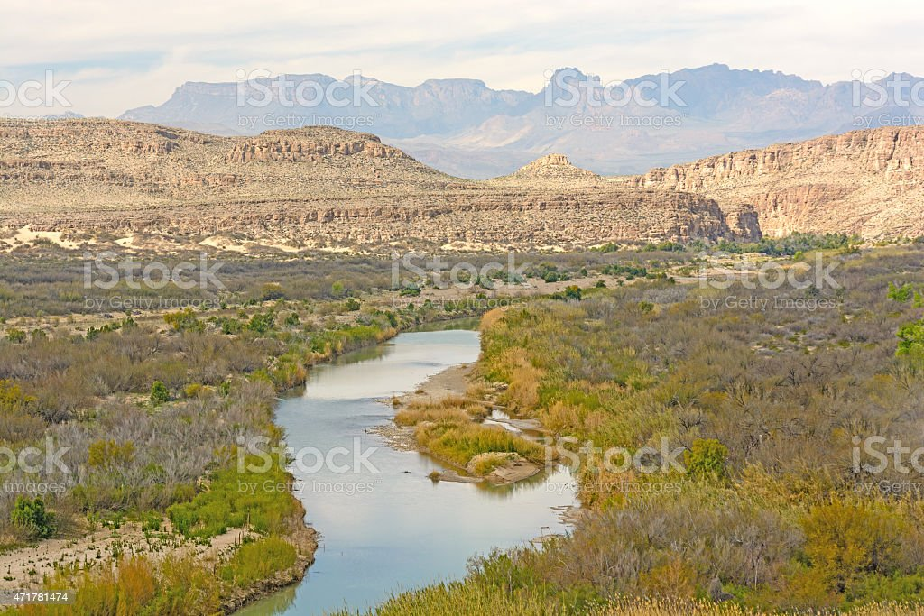 Meandering River Through a Desert Canyon stock photo