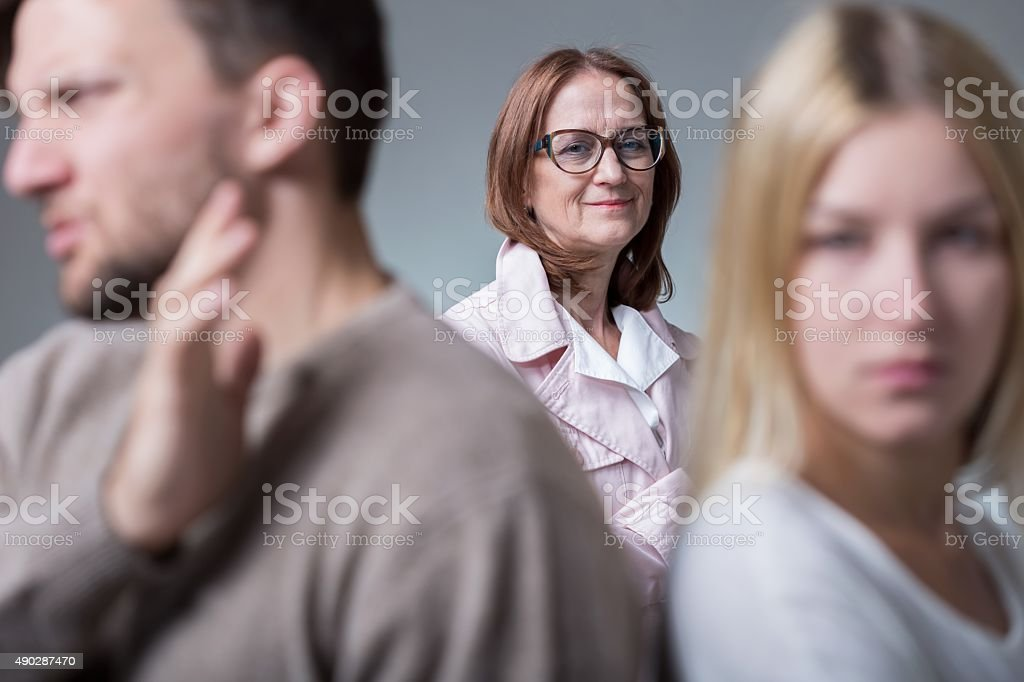Mean-looking happy mother-in-law stock photo