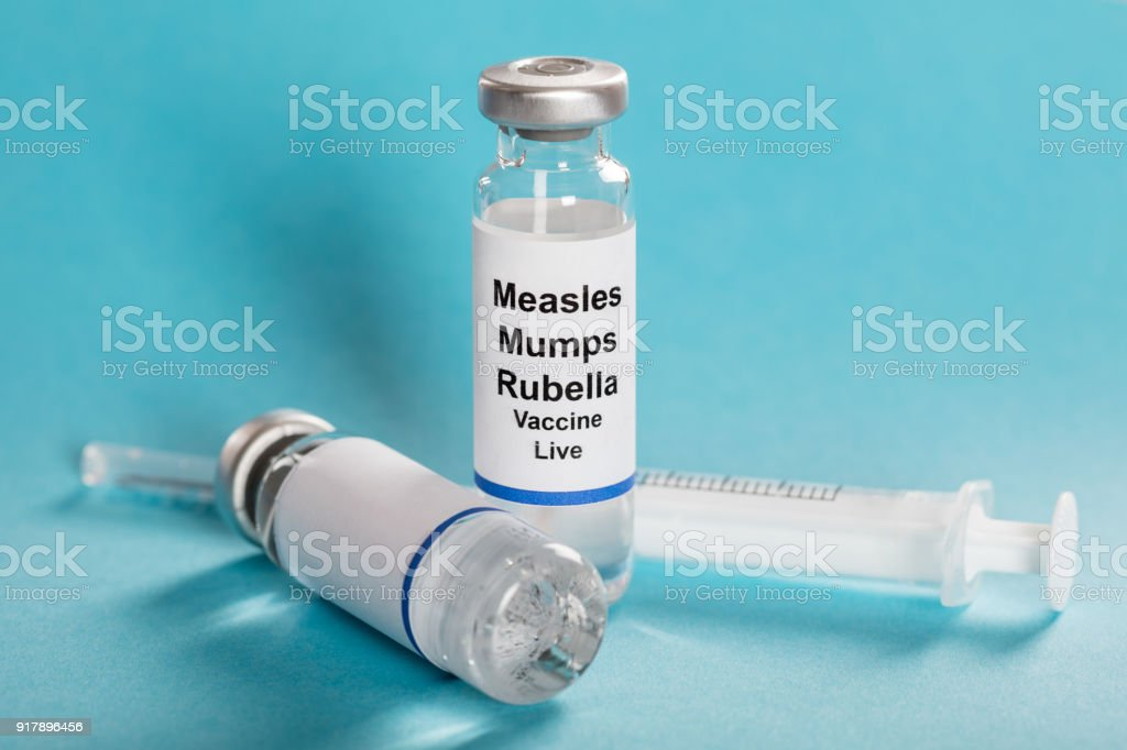 Measles Mumps Rubella Vaccine Vials With Syringe stock photo