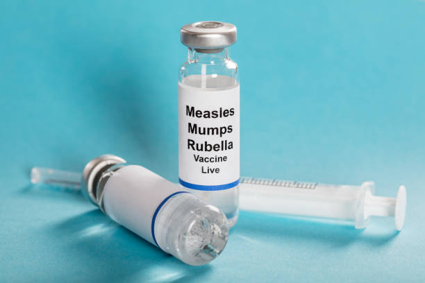Measles Mumps Rubella Vaccine Vials With Syringe Measles Mumps Rubella Vaccine Vials With Syringe Over Turquoise Background measles stock pictures, royalty-free photos & images