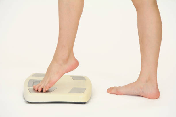 measure a body weight - metabolic syndrome stock photos and pictures