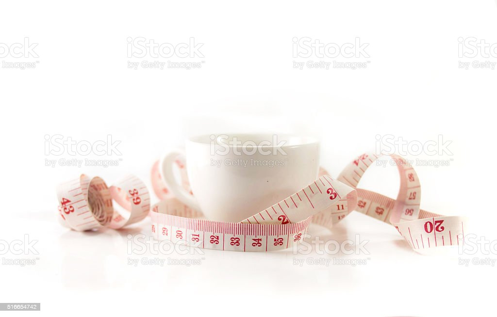 Measure tape in the cup stock photo