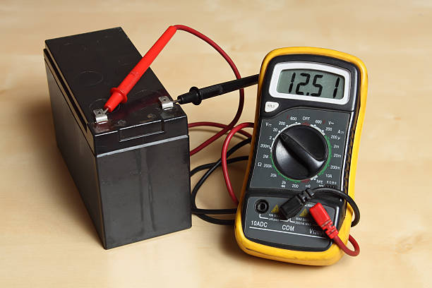 Measure voltage at battery. stock photo