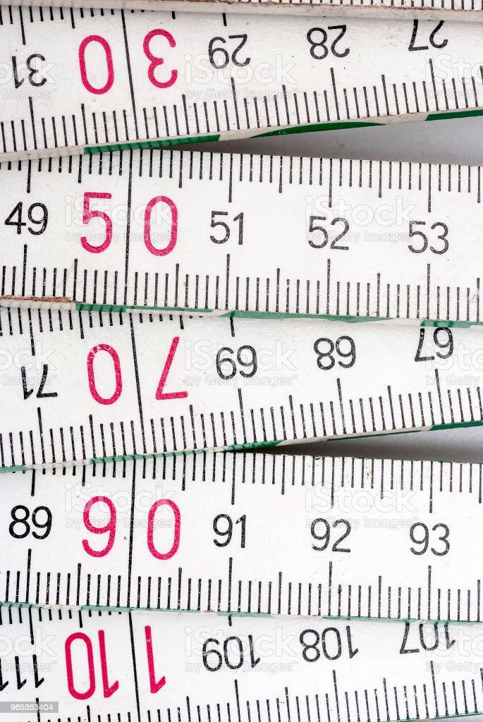Pomiar drewnianego miernika - Zbiór zdjęć royalty-free (Abstrakcja)