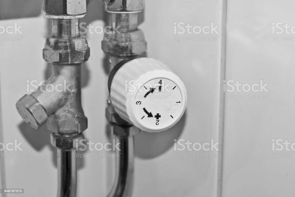 Measurement and Instrumentation Device: Domestic Heating Thermostat and Adjustment (Precision) Knob stock photo