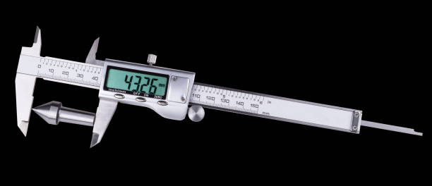 Measurement of conical steel part of machine by digital caliper. Isolated on black background stock photo