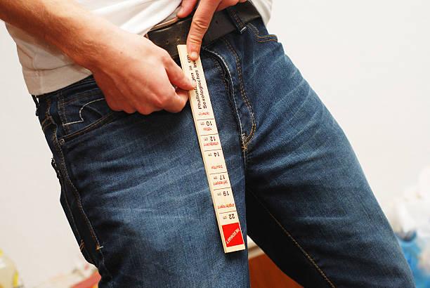measurement of penis - Schwanzlänge stock photo